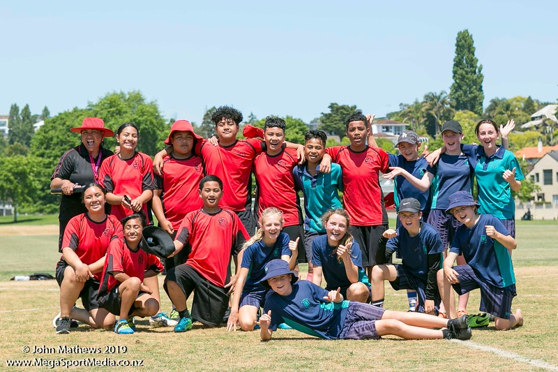 Images of the game between St Thomas (blue) and Point England (red) at the Eastern Zone Touch Tournament for boys, girls and mixed grades held at Madills Farm, Kohimarama, Auckland on 5 November 2019. Copyright: John Mathews 2019.   www.megasportmedia.co.nz