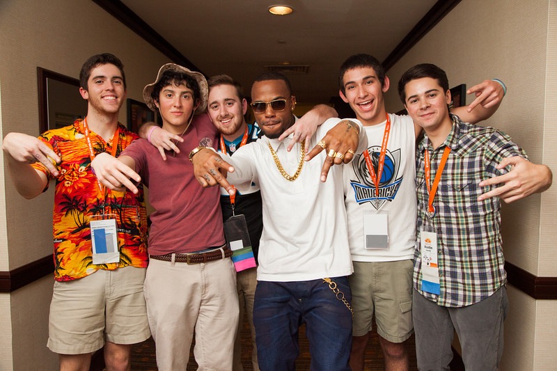 B.o.B. signing autographs for teens who made significant volunteer contributions.