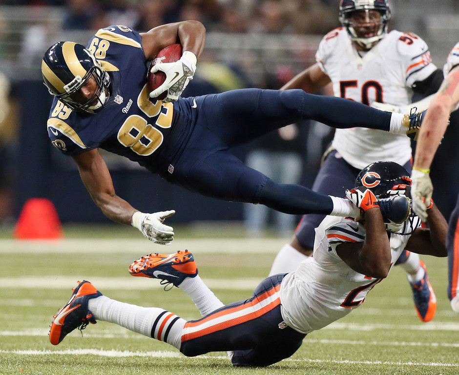 . St. Louis Rams tight end Jared Cook (89) is tackled by Chicago Bears safety Major Wright in the fourth quarter of an NFL football game on Sunday, Nov. 24, 2013, in St. Louis. (AP Photo/St. Louis Post-Dispatch, Chris Lee)
