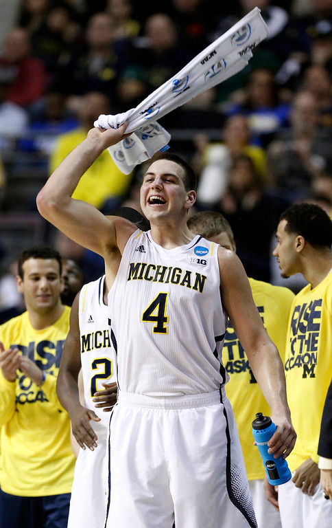 . Michigan forward Mitch McGary (4) cheers on his teammates in the final minutes of their 71-56 win over South Dakota State in a second-round game of the NCAA men\'s college basketball tournament Thursday, March 21, 2013, in Auburn Hills, Mich. (AP Photo/Duane Burleson)