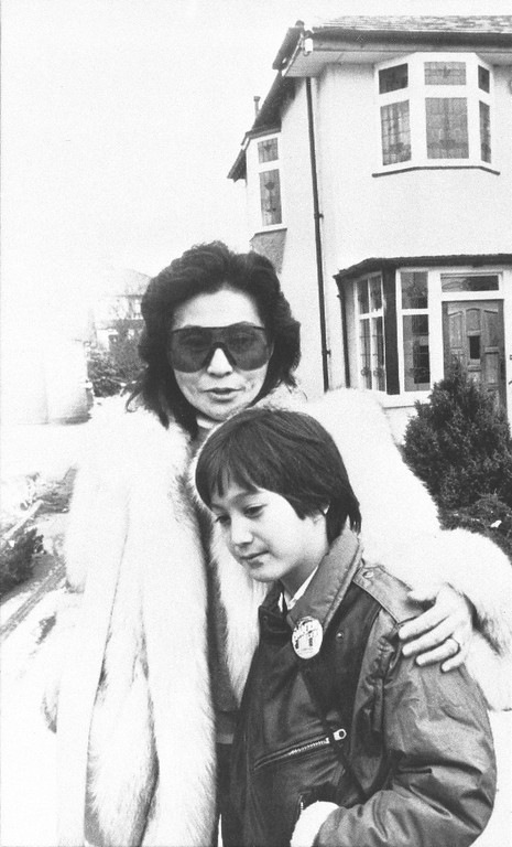 . Yoko Ono, widow of the late John Lennon, poses with their eight-year-old son, Sean, outside Lennon\'s childhood home in Merseyside, Liverpool, England, Tuesday, Jan. 24, 1984.  (AP Photo)