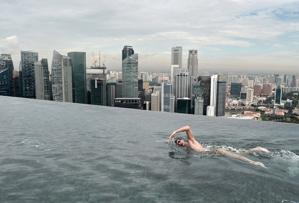 . World Champion Christian Sprenger of Australia swims during a swimming clinic session for children with special needs on the rooftop pool of the Marina Bay Sands resort hotel in Singapore on May 20, 2014. Sprenger is in Singapore to promote the Singapore Swim Stars held in September, a three-day swim festival that includes an unprecedented competition format involving some of the world\'s best swimmers which will showcase a synchronized swimming as well as swimming clinics.  AFP PHOTO/ROSLAN  RAHMAN/AFP/Getty Images