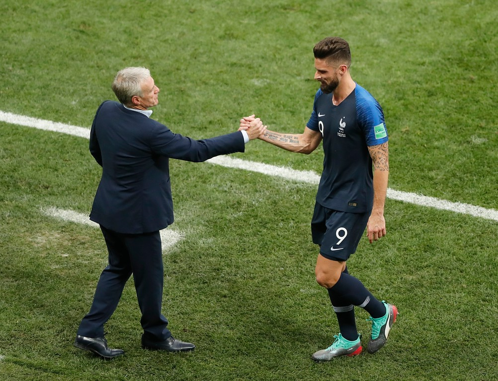 . France head coach Didier Deschamps shakes hands with France\'s Olivier Giroud during the final match between France and Croatia at the 2018 soccer World Cup in the Luzhniki Stadium in Moscow, Russia, Sunday, July 15, 2018. (AP Photo/Frank Augstein)