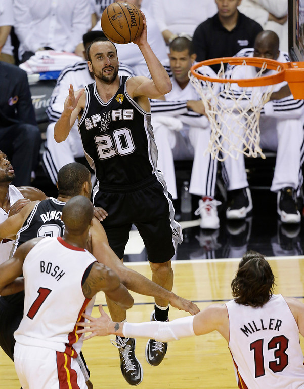 . The San Antonio Spurs\' Manu Ginobili (20) shoots against the Miami Heat during the first half in Game 7 of the NBA basketball championships, Thursday, June 20, 2013, in Miami. (AP Photo/Wilfredo Lee)