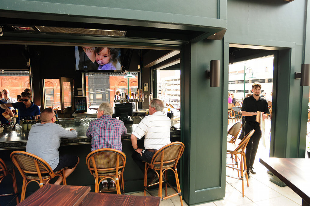 . Patrons can watch flat-screen television at the covered patio bar at Louis, atop the West Seventh Street institution Cosetta, in St. Paul. (Pioneer Press: Scott Takushi)