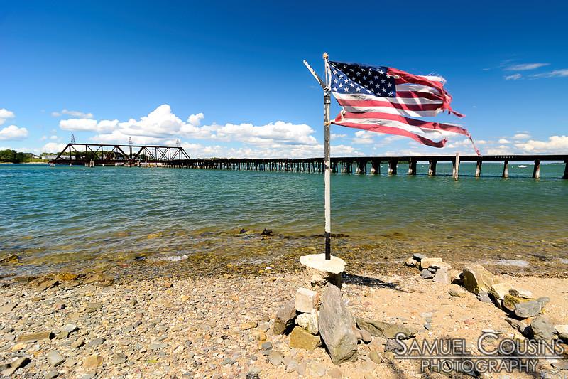 Torn up flag near the old railroad bridge