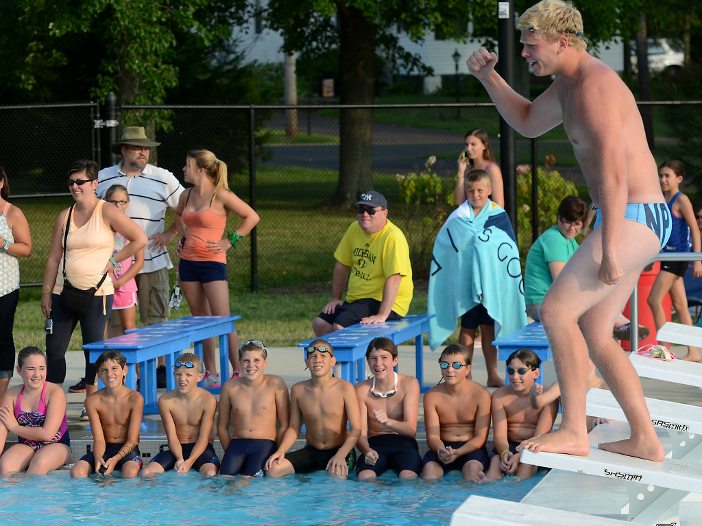 . The Hatfield Swim Team rallies together before the start of their meet against  Nor Gwyn  at the Hatfield Aquatic Center  on Tuesday July 22,2014.Photo by Mark C Psoras/The Reporter