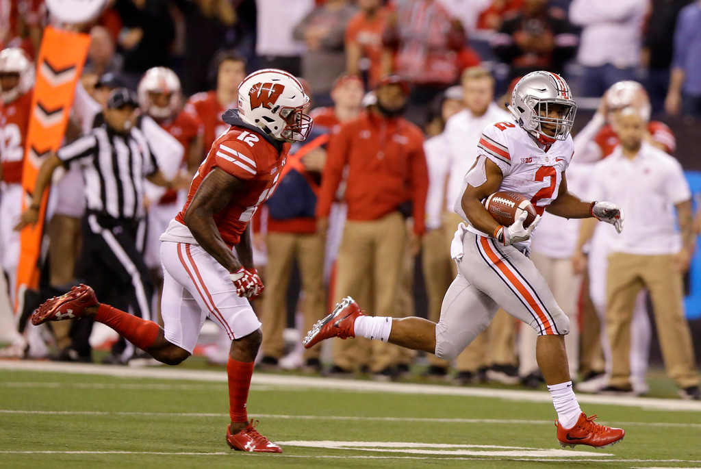 . Ohio State running back J.K. Dobbins, right, runs with the ball during the second half of the Big Ten championship NCAA college football game against Wisconsin, Saturday, Dec. 2, 2017, in Indianapolis. (AP Photo/Michael Conroy)