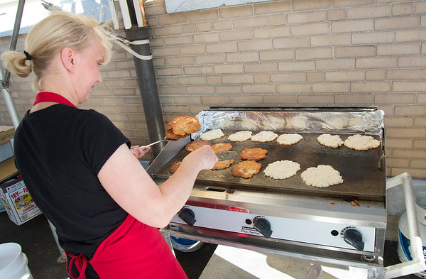 06/28/19 Wesley Bunnell | Staff The Sacred Heart Partish Festival, Odpus, opened Friday June 28, 2019 and will continue thru Saturday. Pagusia Wyzrzyski cooks potato pancakes for hungry visitors.