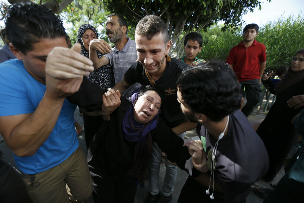 . The mother of one of the four boys, all from the Bakr family, killed during Israeli shelling, collapses outside the al-Shifa hospital in Gaza City, on July 16, 2014. Four children were killed and several injured at a beach in Gaza City medics said, in Israeli shelling witnessed by AFP journalists. The strikes appeared to be the result of shelling by the Israeli navy against an area with small shacks used by fishermen. The deaths raised the overall toll in nine days of violence in Gaza to 213. AFP PHOTO / MOHAMMED ABED/AFP/Getty Images