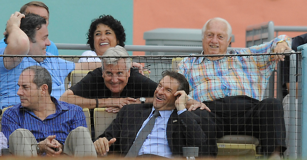 . Tommy Lasorda, right, sits in the owners box with club VIP\'s that inclde some of the owners. The Dodgers ended the season on a high note with a 5-1 victory over the San Francisco Giants at Dodger Stadium. Los Angeles,CA 10/3/2012(photos by John McCoy/Staff Photographer)