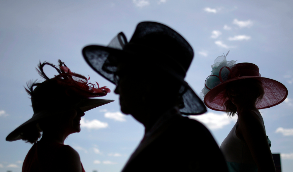 Description of . Women make their way to the grandstand before the 140th running of the Kentucky Derby horse race at Churchill Downs Saturday, May 3, 2014, in Louisville, Ky. (AP Photo/David Goldman)