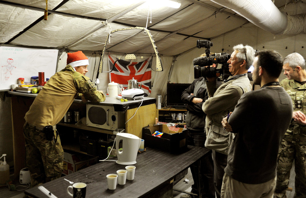 . This picture taken on December 12, 2012 shows Britain\'s Prince Harry talking to a TV crew whilst preparing his breakfast at the VHR (very high readiness) tent close to the flight-line at Camp Bastion in Afghanistan\'s Helmand Province, where he was serving as an Apache Helicopter Pilot/Gunner with 662 Sqd Army Air Corps. Britain\'s Prince Harry confirmed he killed Taliban fighters during his stint as a helicopter gunner in Afghanistan, it can be reported after he completed his tour of duty on January 21, 2013. JOHN STILLWELL/AFP/Getty Images