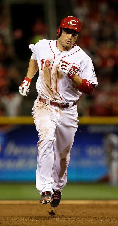 . Cincinnati Reds\' Joey Votto rounds the bases after hitting a two-run home run off Los Angeles Dodgers relief pitcher J.P. Howell in the fifth inning of a baseball game, Friday, Sept. 6, 2013, in Cincinnati. (AP Photo/Al Behrman)