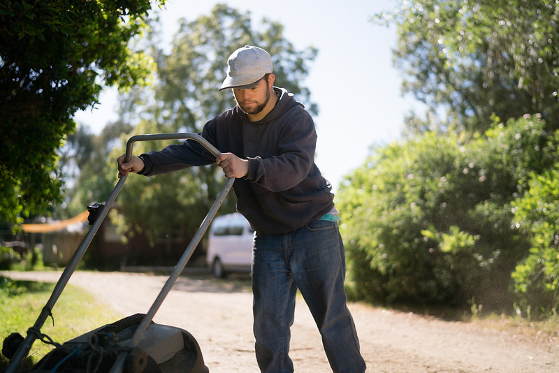 Man with Cap Mowing