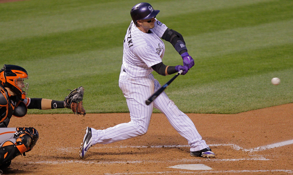 . Colorado Rockies\' Troy Tulowitzki (2) hits a  solo home run off of San Francisco Giants\' Madison Bumgarner during the fourth inning of a baseball game, Tuesday, April 22, 2014, in Denver. (AP Photo/Barry Gutierrez)