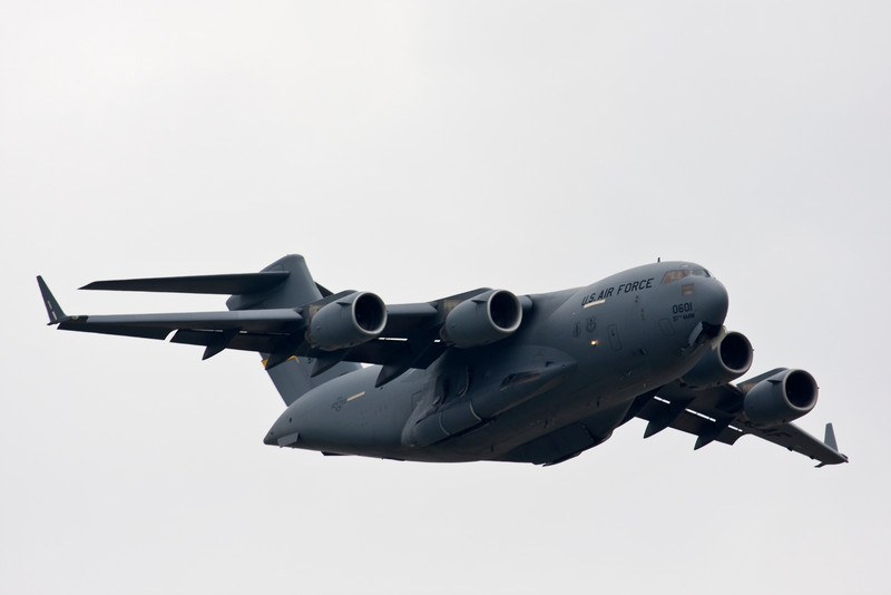 C-17 in the final phase of retracting its gear.