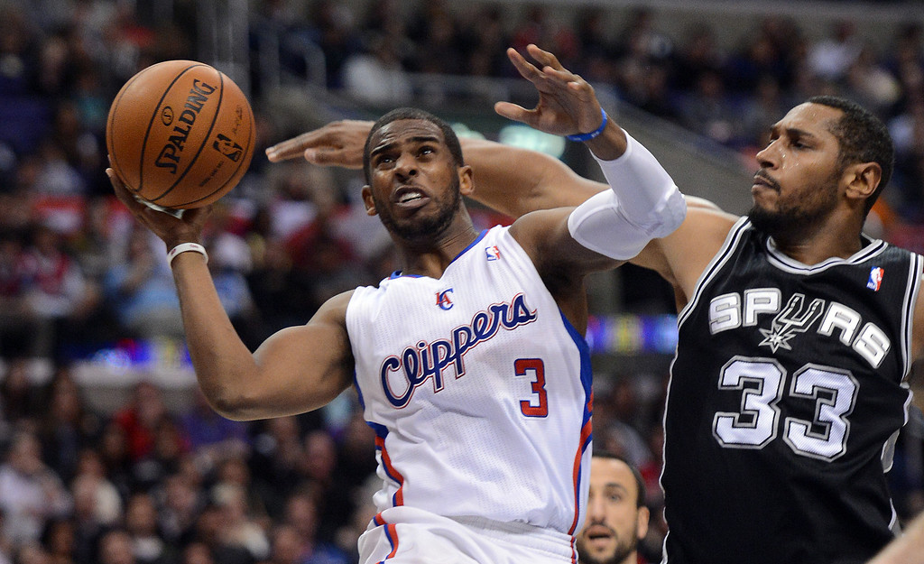 . The Clippers\' Chris Paul #3 shoots as the Spurs\' Boris Diaw #33 defends during their game at the Staples Center in Los Angeles Friday, February  21, 2013. The Spurs beat the Clippers 116-90. (Hans Gutknecht/Staff Photographer)