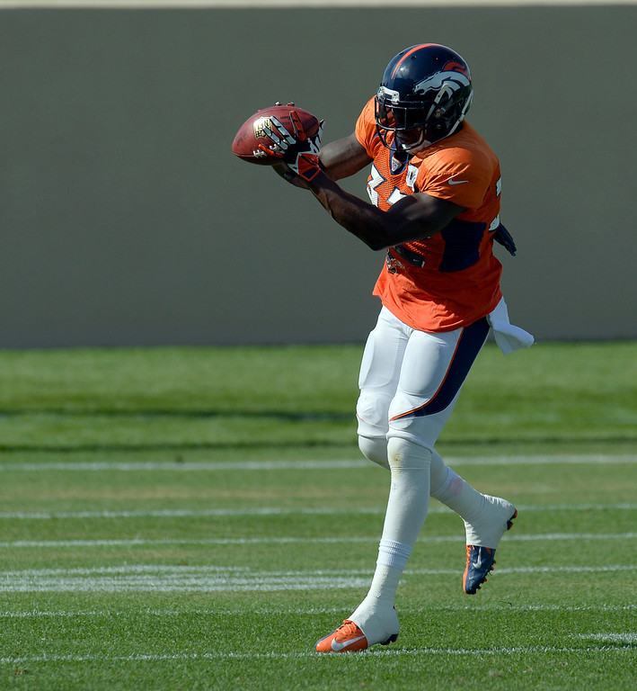 . Denver Broncos S Duke Ihenacho (33) catches a pass in drills during training camp August 6, 2013 at Dove Valley. (Photo By John Leyba/The Denver Post)