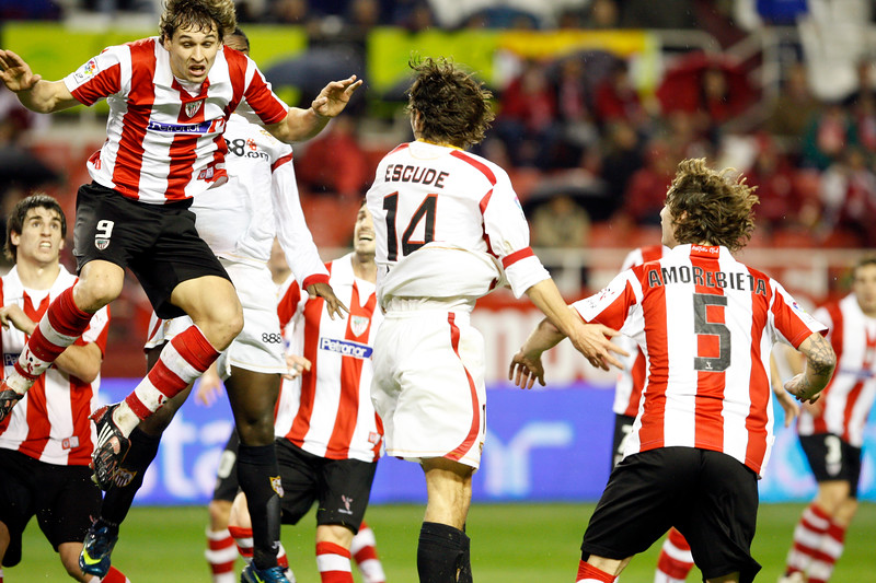 Fernando Llorente (9, Athletic), jumping. Taken in the Sanchez Pizjuan stadium on 4 Feb 2009 during the King's Cup semifinal game between the football teams Sevilla FC and Athletic Club of Bilbao, town of Seville, autonomous community of Andalusia, southern Spain