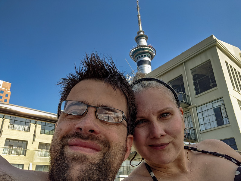 Chilling at the rooftop pool, Sky Tower in background.