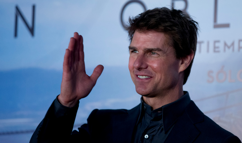 ". U.S. actor Tom Cruise waves to the media during a presentation to promote his film ""Oblivion\"" in Buenos Aires, Argentina,  Tuesday, March 26, 2013. (AP Photo/Natacha Pisarenko)"