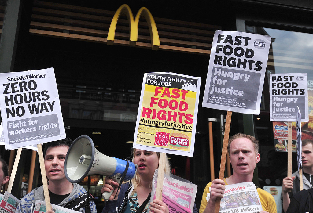 . Fast food workers protest for higher wages outside a branch of McDonalds in central London on May 15, 2014. Fast-food restaurant employees held a global day of protest and strike action in a push for better pay and conditions. AFP PHOTO / CARL COURT/AFP/Getty Images