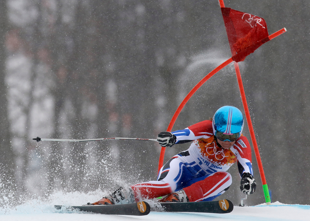 Description of . France's Anemone Marmottan passes a gate in the second run of the women's giant slalom at the Sochi 2014 Winter Olympics, Tuesday, Feb. 18, 2014, in Krasnaya Polyana, Russia. (AP Photo/Luca Bruno)