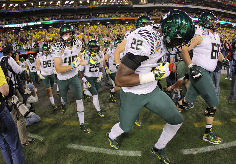 . The Oregon Ducks take the field for the Tostitos Fiesta Bowl against the Kansas State Wildcats at University of Phoenix Stadium on January 3, 2013 in Glendale, Arizona.  (Photo by Doug Pensinger/Getty Images)