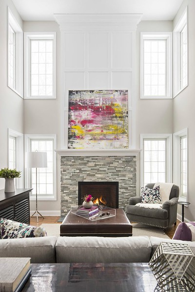 painting-over-fireplace-living-room-transitional-with-stacked-stone-contemporary-office-chairs.jpg