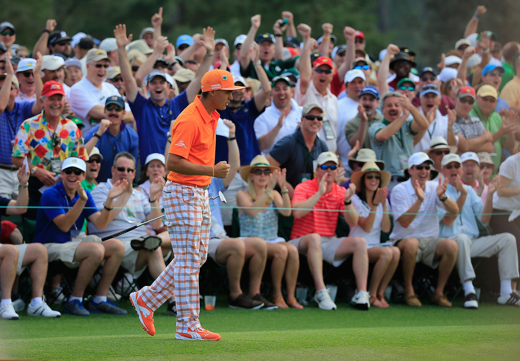 . Rickie Fowler of the United States reacts to a long putt on the ninth green during the final round of the 2014 Masters Tournament at Augusta National Golf Club on April 13, 2014 in Augusta, Georgia.  (Photo by Rob Carr/Getty Images)