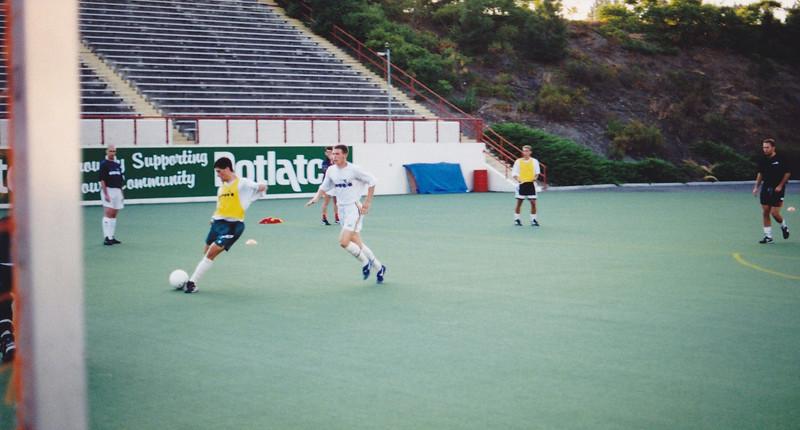Chris LaRochelle shoots with Joe Marks challenging as Kieran Barton (far right) looks on.