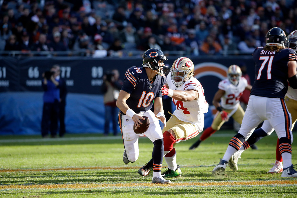 . San Francisco 49ers defensive end Solomon Thomas (94) pressures Chicago Bears quarterback Mitchell Trubisky (10) during the second half of an NFL football game, Sunday, Dec. 3, 2017, in Chicago. (AP Photo/Nam Y. Huh)