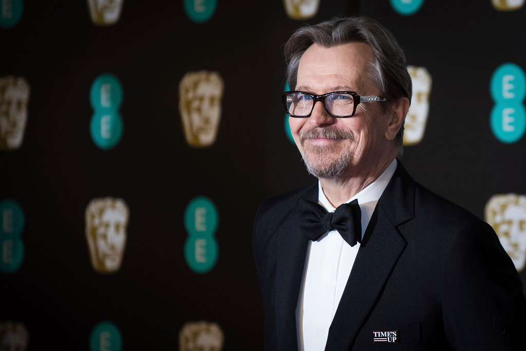 . Gary Oldman poses for photographers upon arrival at the BAFTA Film Awards, in London, Sunday, Feb. 18, 2018. (Photo by Vianney Le Caer/Invision/AP)