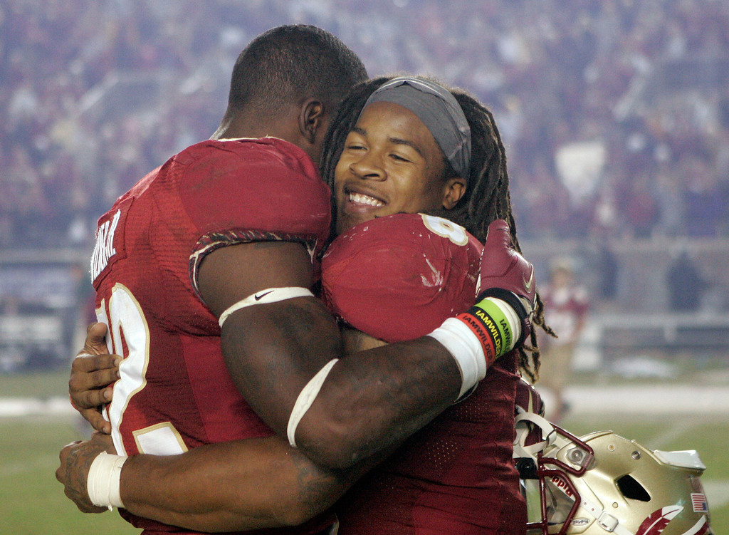 . Florida State running back Devonta Freeman, right, hugs fellow unning back James Wilder Jr. after the team defeated Miami 41-14 in an NCAA college football game Saturday, Nov. 2, 2013, in Tallahassee, Fla. Freeman had three touchdowns in the win. (AP Photo/Steve Cannon)