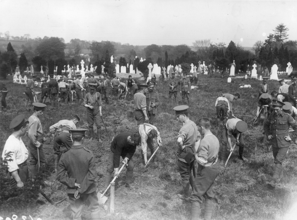 . May 1915:  In an old churchyard in Queenstown, Ireland soldiers dig graves for the victims of the Lusitania disaster. (Photo by Topical Press Agency/Getty Images)