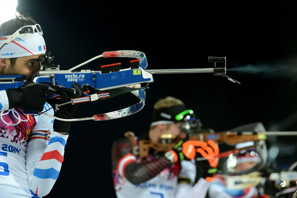 . Gold winner France\'s Martin Fourcade shoots at the range as he competes in the Men\'s Biathlon 12,5 km Pursuit at the Laura Cross-Country Ski and Biathlon Center during the Sochi Winter Olympics on February 10, 2014 in Rosa Khutor near Sochi.  KIRILL KUDRYAVTSEV/AFP/Getty Images