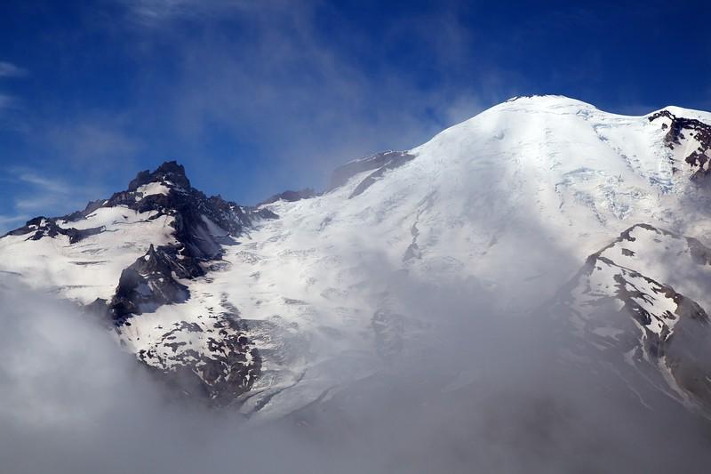 Mt Rainier through the clouds. Mount Rainier National Park, Washington.