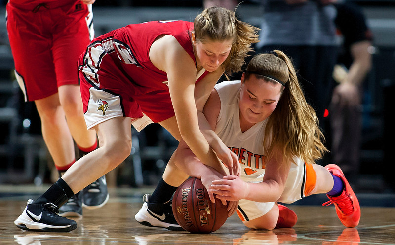 BANGOR, Maine -- 03/04/2017 -- Vinalhaven's Paige A. Dennison (left) and Shead's Halle Sullivan battle for a loose ball during their Class D girls basketball state championship at the Cross Insurance Center in Bangor Saturday. Ashley L. Conti | BDN