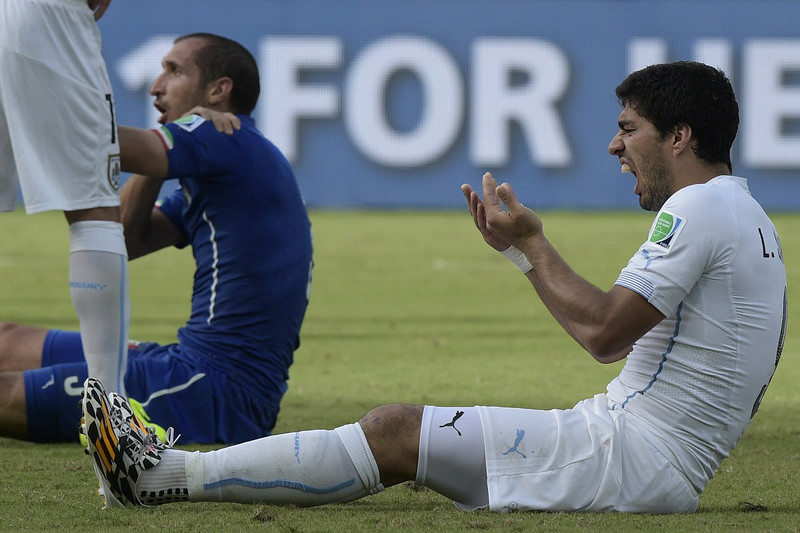 . Uruguay\'s forward Luis Suarez reacts during a Group D football match between Italy and Uruguay at the Dunas Arena in Natal during the 2014 FIFA World Cup on June 24, 2014. Uruguay won 1-0.    AFP PHOTO/DANIEL GARCIADANIEL GARCIA/AFP/Getty Images