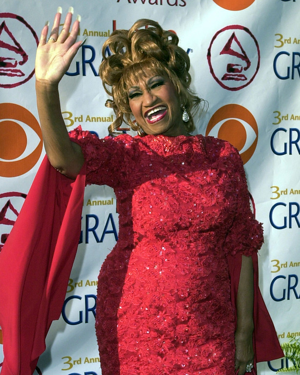 . Cuban salsa queen Celia Cruz poses for photographers as she arrives at the 3rd annual Latin Grammy Awards Wednesday, Sept. 18, 2002, in the Hollywood district of Los Angeles. (AP Photo/Kim D. Johnson)