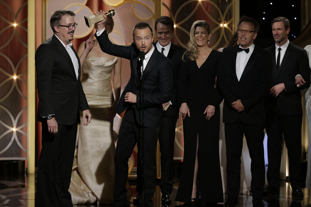 """. In this handout photo provided by NBCUniversal, Vince Gilligan, Anna Gunn, Aaron Paul,  Michelle MacLaren and Mark Johnson  accept the award for Best TV Series, Drama for \""""Breaking Bad\"""" during the 71st Annual Golden Globe Award at The Beverly Hilton Hotel on January 12, 2014 in Beverly Hills, California.  (Photo by Paul Drinkwater/NBCUniversal via Getty Images)"""
