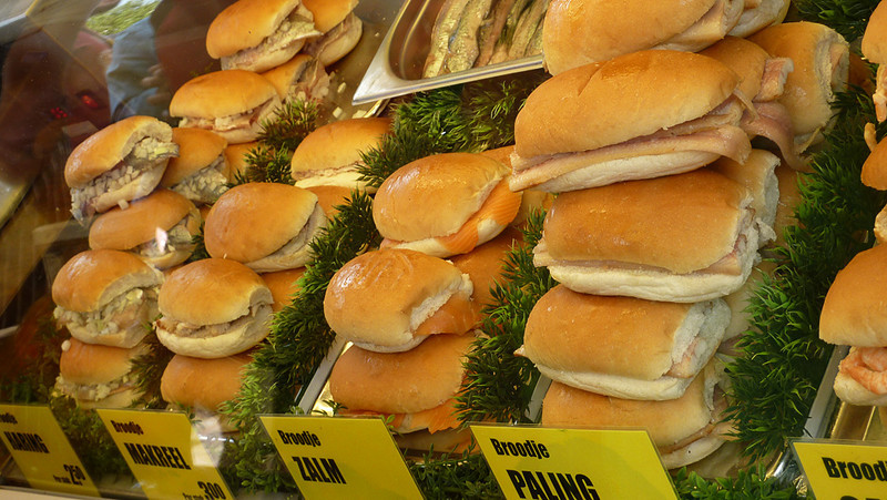 Traditional fish sandwiches at the Alkmaar street market. These are all fish on a bun, served with onions. you can see herring (haring), mackerel (makreel), salmon (zalm) and I'm not sure what else!