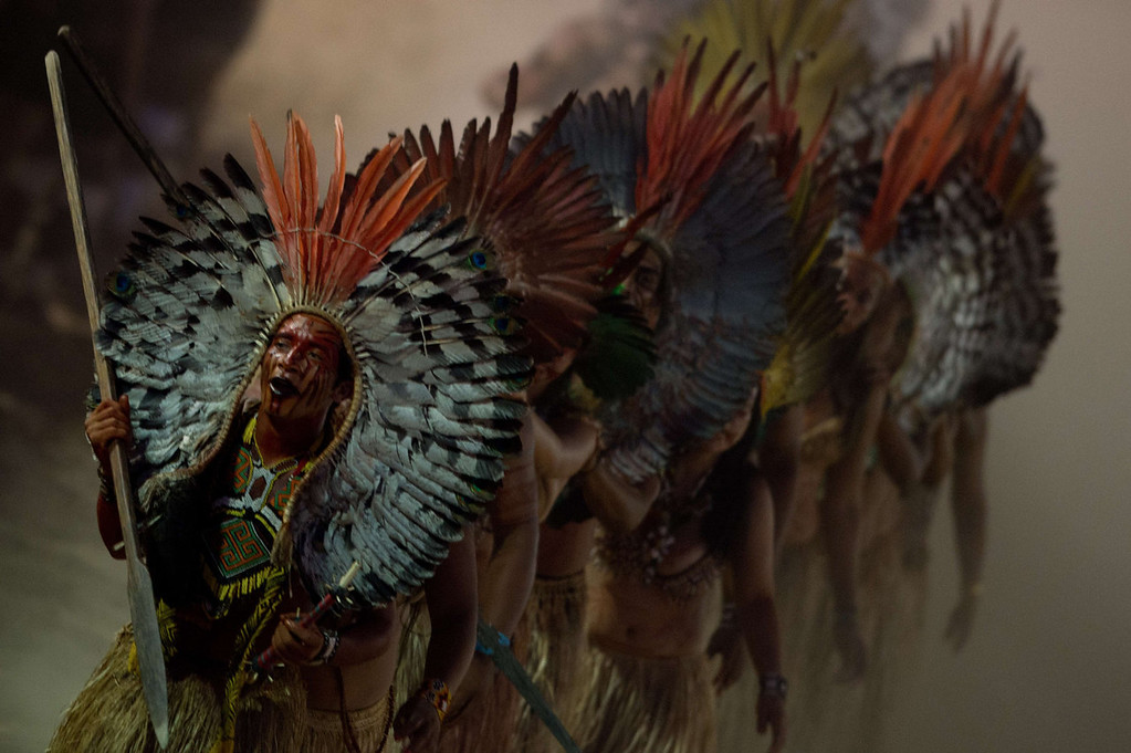 . Natives parade during the opening ceremony of the International Games of Indigenous Peoples, in Cuiaba, state of Mato Grosso, on November 9, 2013.     AFP PHOTO / CHRISTOPHE SIMON