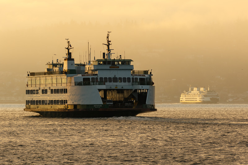 The Washington state ferry Kittitas approaches Mukilteo in early morning light with another ferry behind it - Mukilteo, Mukilteo, Washington, United States (US)