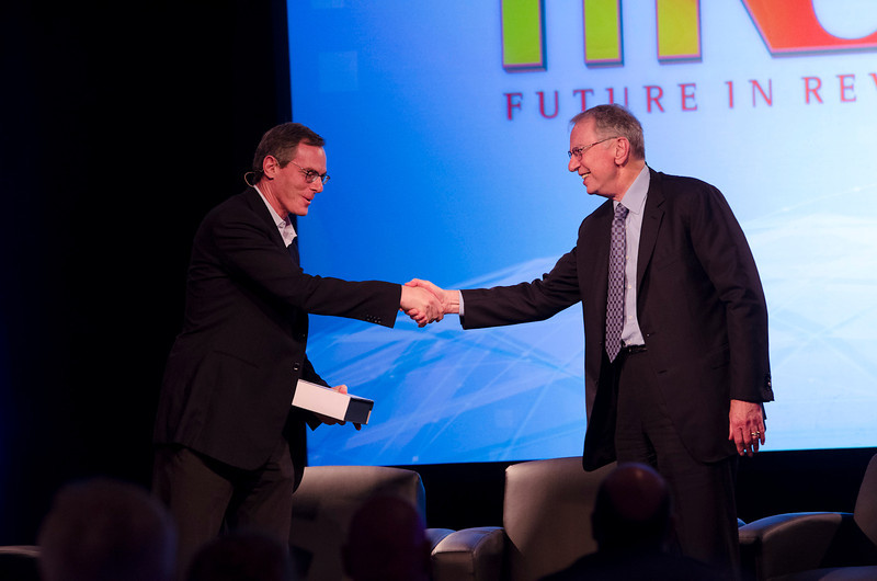 "Qualcomm Chairman and CEO Paul Jacobs is congratulated by his father, Chairman Emeritus Irwin Jacobs, for being named FiRe X ""CEO of the Year.""   CMay 22-25, 2012: At the Montage in Laguna Beach, CA, 200 thought leaders - high technology engineers and executives, entrepreneurs, scientists, and media professionals - gathered for 3 days to participate in FiRe X, the 10th annual Future in Review conference, presented by the Strategic News Service and led by SNS founder and technology visionary Mark Anderson. Interviews, panel discussions, and informal conversations ranged from IP protection to CO2 and climate change, new healthcare paradigms, global economics, ocean toxins, robotics, documentary filmmaking,  medical diagnostics, technology solutions for social issues, global economics, mobile computing, and tech solutions to human trafficking and aging with dignity."