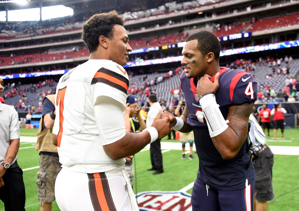 . Cleveland Browns quarterback DeShone Kizer (7) and Houston Texans quarterback Deshaun Watson (4) meet at midfield after their NFL football game, Sunday, Oct. 15, 2017, in Houston. (AP Photo/Eric Christian Smith)