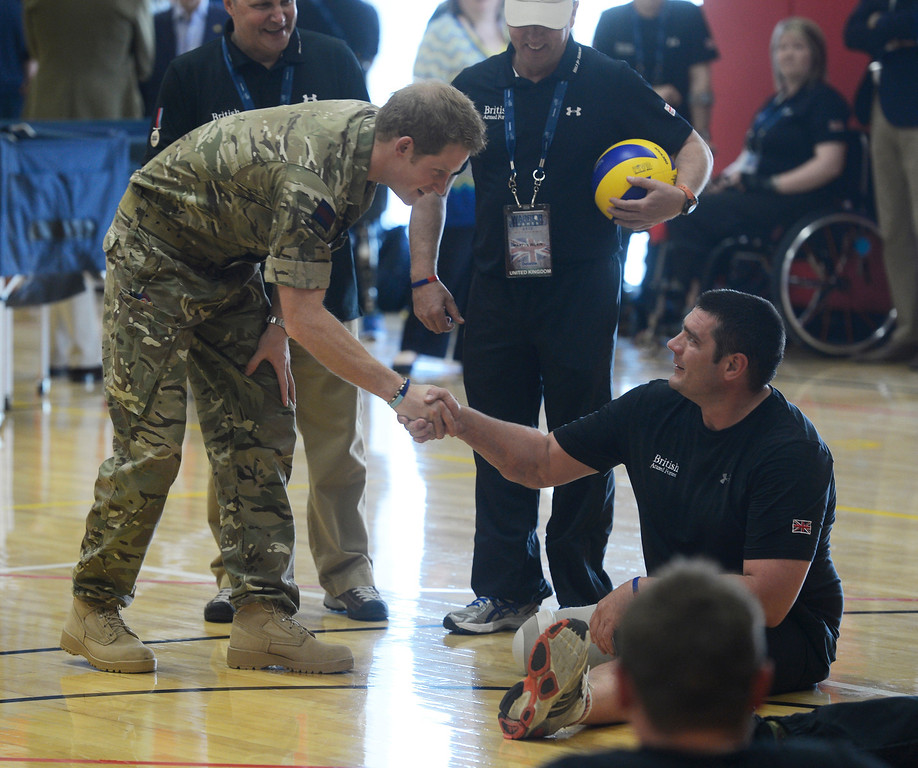 . COLORADO SPRINGS, CO - MAY 11: Britain\'s Prince Harry greets Allen Henderson, British Armed Forces, Royal Marines, at the United States Olympic Training Center before the 2013 Warrior Games Saturday morning, May 11th, 2013. Henderson plays for the British Armed Forces volleyball team, he lost his foot from an IED explosion in Afghanistan in 2010(Photo By Andy Cross/The Denver Post)