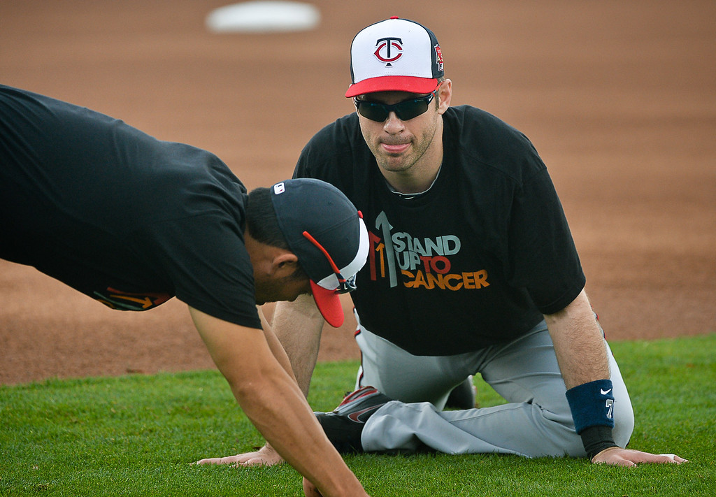 . Former catcher Joe Mauer, right, chats with new catcher Kurt Suzuki during warm ups. (Pioneer Press: Ben Garvin)