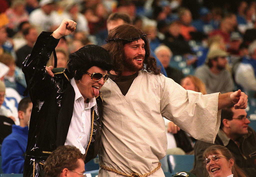 . Elvis and Jesus were seen mugging for TV cameras during the Detroit Lions\' 29-27 loss to the Green Bay Packers Thursday at the Pontiac Silverdome.